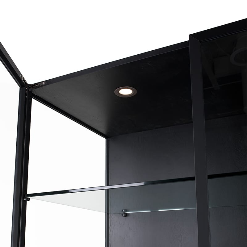 Mariana curio features a light inside its glass cabinet doors