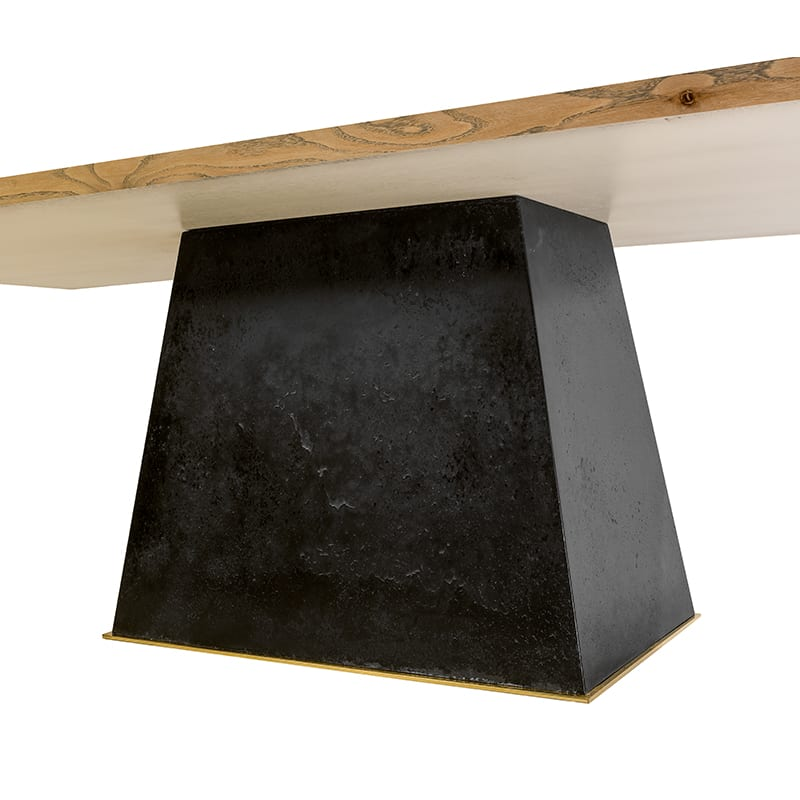 Solid concrete base with a touch of brass on Leverage Dining Table by Facet Furniture